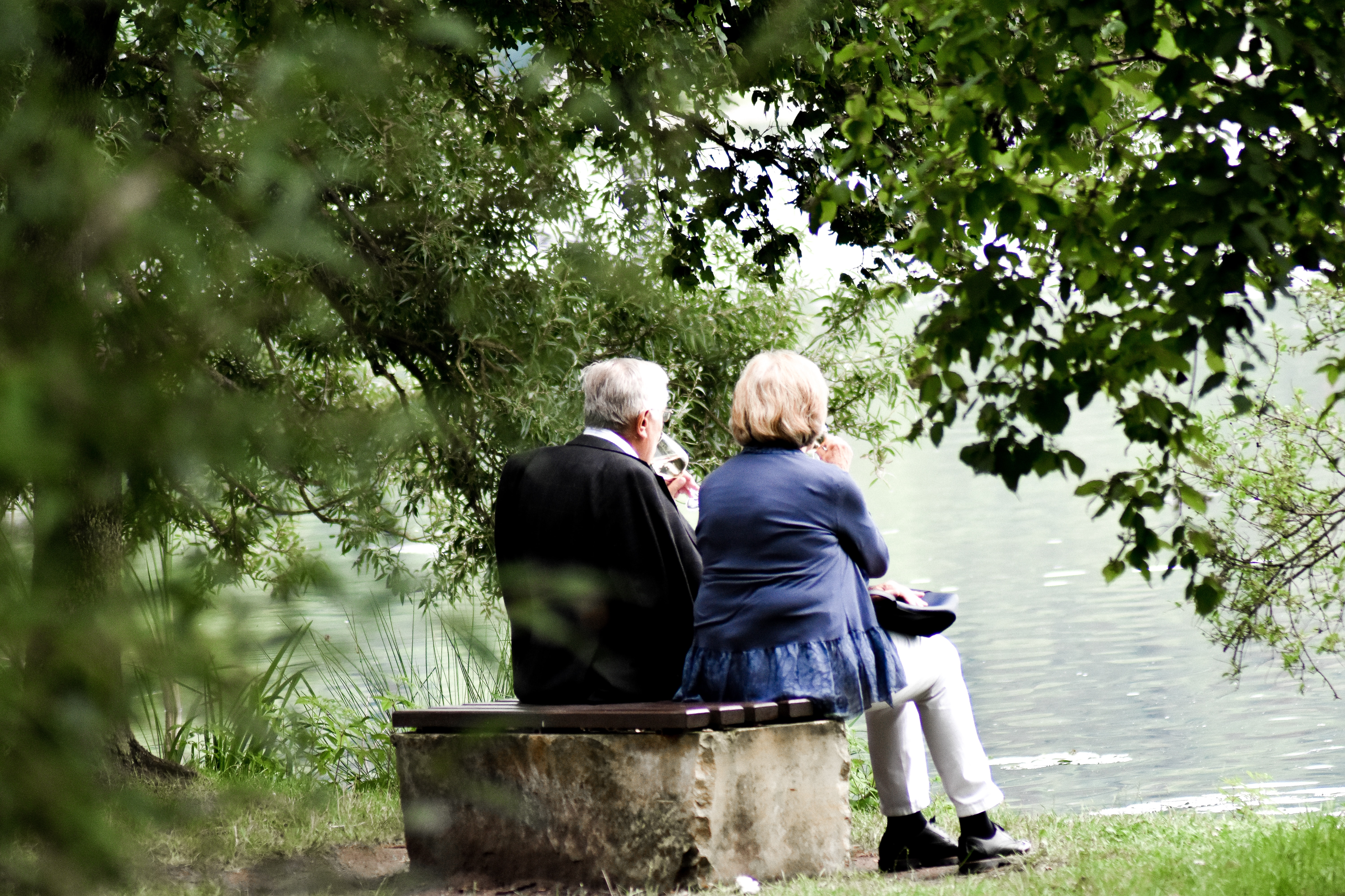 two older adults remembering loved ones